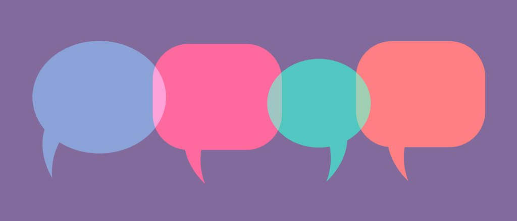A purple background with four speech bubbles that are different colours; blue, fuchsia, teal, and salmon.